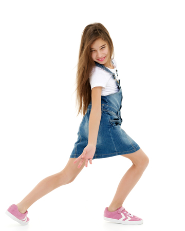 Photo for A cheerful little girl is dancing. - Royalty Free Image