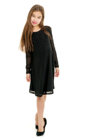 Foto de Little girl in large size shoes. - Imagen libre de derechos