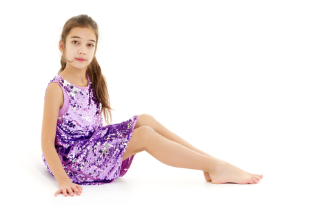 Photo for Little girl is sitting on the floor. - Royalty Free Image