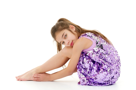 Photo for Little girl hugging her knees. - Royalty Free Image