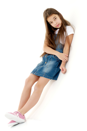 Photo pour Little girl in a short denim dress. - image libre de droit