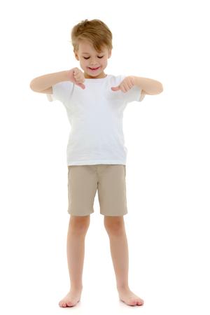 Photo pour A little boy in a pure white T-shirt points his fingers at her. - image libre de droit