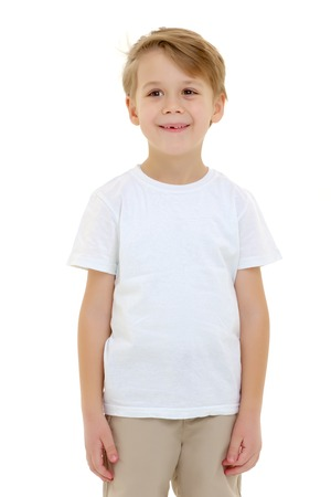 Photo for Emotional little boy in a pure white t-shirt. - Royalty Free Image