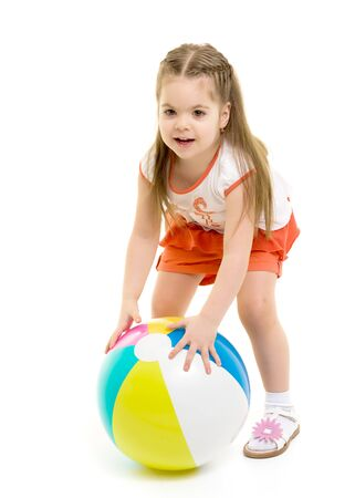 Photo for Little girl is playing with a ball - Royalty Free Image