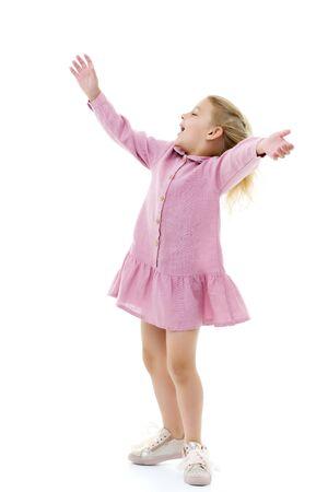 Photo pour A little girl in a dress is spinning. - image libre de droit