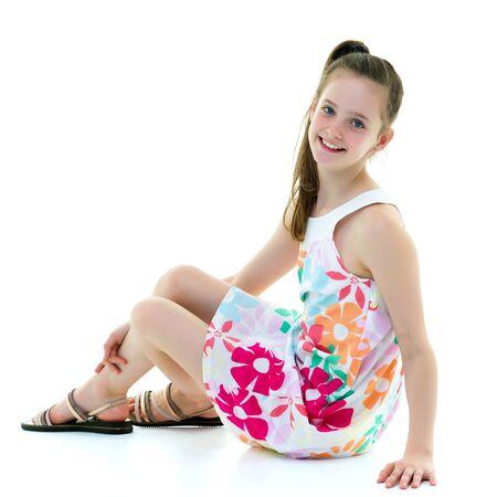 Photo pour A teenage girl is sitting on the floor. - image libre de droit