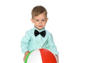 Foto per A little boy is playing with a ball. - Immagine Royalty Free