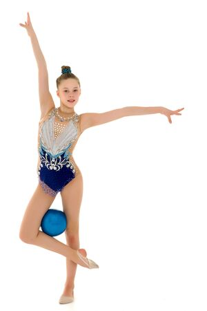 Photo pour little girl is engaged in fitness with a ball. - image libre de droit