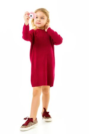 Photo pour Lovely Blonde Little Girl Making Selfie with Toy Camera - image libre de droit