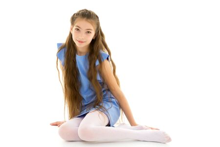 Photo pour Little girl is sitting on the floor.The concept of a happy child - image libre de droit