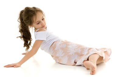 Photo for Beautiful Preteen Girl Lying on the Floor Against White Background - Royalty Free Image