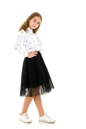 Photo pour Beautiful school girl with long silky hair. - image libre de droit