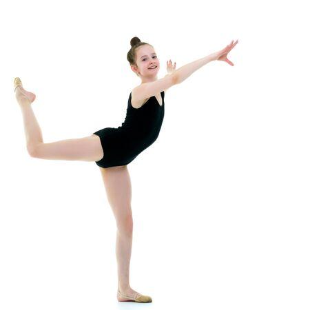 Photo pour The gymnast perform an acrobatic element. - image libre de droit