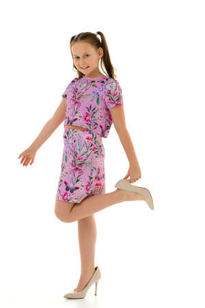 Photo for Cheerful little girl in large shoes taken from her mother. - Royalty Free Image
