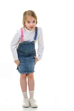 Photo pour Little girl in a short denim dress. - image libre de droit