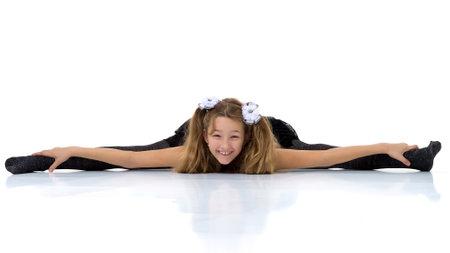 Photo pour Girl sitting on floor with her legs wide apart - image libre de droit