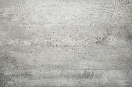 Photo pour Grey wood texture background viewed from above. The wooden planks are stacked horizontally and have a worn look. - image libre de droit