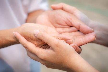 Foto de Asian senior and asian young holding hands. - Imagen libre de derechos