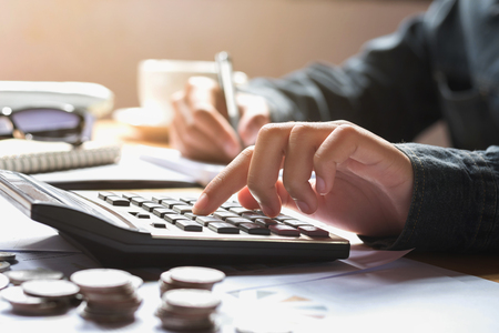Foto de businesswoman using calculator for calculate finance accounting in office - Imagen libre de derechos