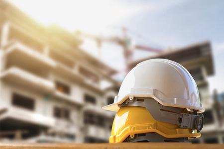Photo pour Yellow and white helmet safety in construction site - image libre de droit