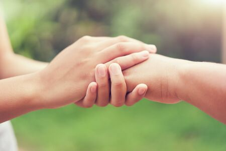 Photo pour people old and young hand holding with sunlight. concept power of hope - image libre de droit