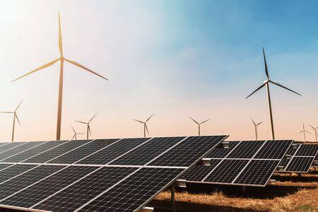 Photo pour clean energy concept. solar panel with wind turbine and blue sky - image libre de droit