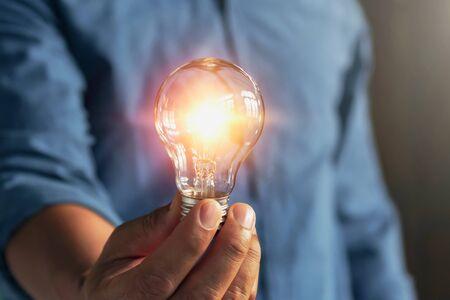 Photo for businessman hand holding lightbulb. idea Alternative energy concept saving electricity - Royalty Free Image