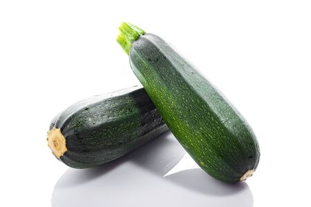 Foto de Zucchini or green marrow squash  isolated on white background - Imagen libre de derechos