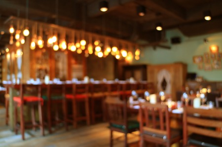 Photo pour Blurred wooden interior of the restaurant in warm color with bokeh light, Background - image libre de droit