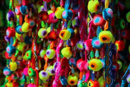 Multi color Vivid Andean Pompom Displayed at the Shop in a Village of Bolivia