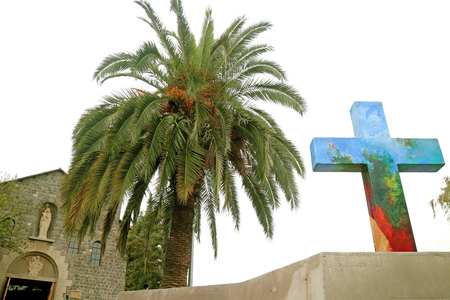 Colorful Decorative Cross at Templo Maternidad de Maria Church on San Cristobal Hilltop, Historic place in Santiago, Chile