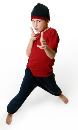Expressive boy in casual clothes standing barefoot on a white background