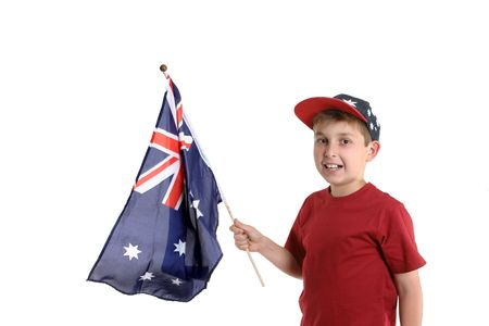 Young boy proudly holding an Australian flag in his hand.
