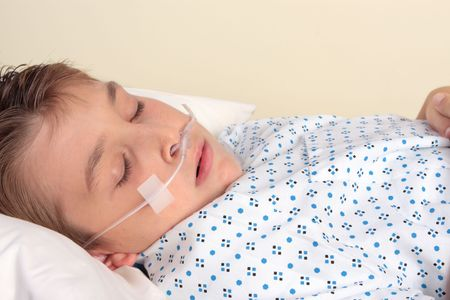 Sick child with nasal cannula.   a nasal cannula deliver from 24% to 40% oxygen at a flow rate of 0.26-1.58 gal (1-6 L) per minute.  Used for patients suffering respiratory disease, cardiac disease, shock, trauma, severe electrolyte imbalance (hypokalemia