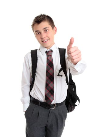 School boy pre teen in high school uniform showing the  thumbs up hand sign