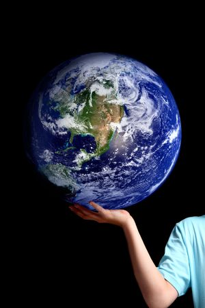 A person holds balances the earth in the palm of his hand.  Set against a dark background, concept for environment issues, global issues,travel, geopolitical, save the planet, etc.   Or replace the earth with your own object