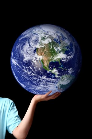 The whole earth is my birthplace and all humans are my brothers.... Kahil Gibran.  A person holds balances the earth in the palm of his hand.  Set against a dark background, concept for world peace, environment issues, global issues, travel, save the plan