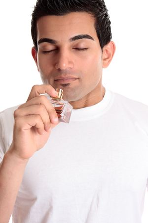 A guy or customer holds a bottle of perfume cologne to smell its fragrance scent.
