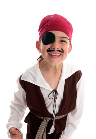A happy young  boy wearing a pirate costume.  White background.