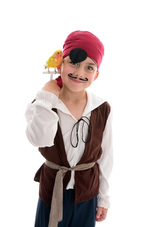 A young boy in pirate costume and holding a pet lovebird
