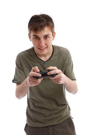 Happy teen boy playing a computer game using a wireless console.  White background,