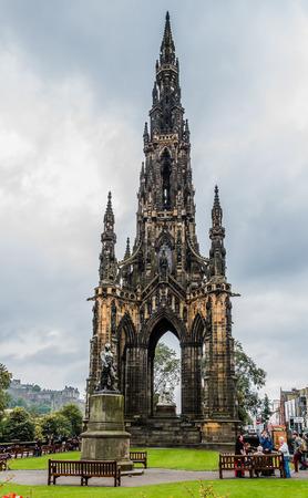 Edinburgh, Scotland - September 14, 2014: Scott Monument and Livingstone statue, located in the Princes Street Gardens in Edinburgh.