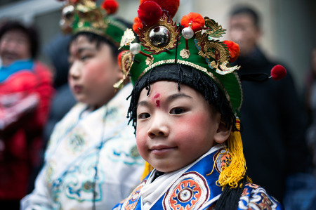 Paris, France - February 17, 2013:  Chinese boy in traditional clothing at the Lunar New Year Festival.