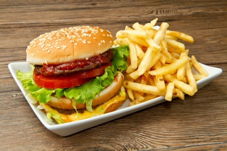 hamburger with potatoes on wooden background