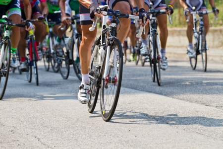 The cyclists riding by at the bicycle race