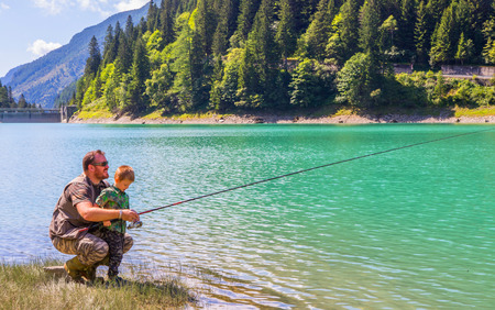 Foto per happy family fishing together - Immagine Royalty Free