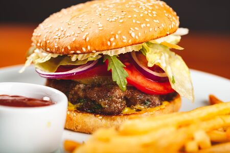 Photo for Fast food. Homemade hamburger and french fries on white plate. - Royalty Free Image