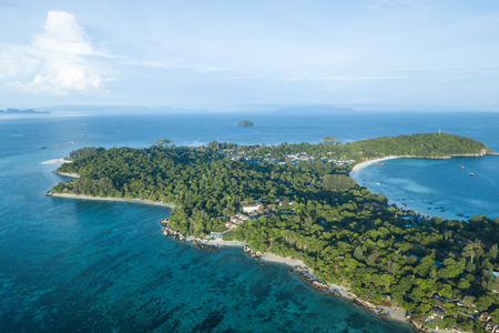 High aerial overview of entire tropical Lipe Island and Andman Sea in Satun province, Thailand.