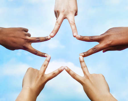 Photo for Black and white people forming five pointed star with their fingers. - Royalty Free Image