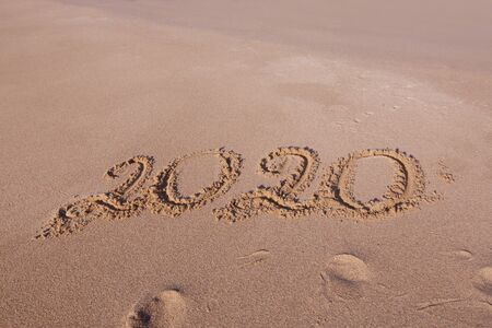 Happy New Year 2020 Lettering On The Beach Numbers 2020 Year On The Sea Shore Message Handwritten In The Golden Sand On Beautiful Beach Background New Years Concept Royalty Free Images Photos And